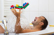man playing in the bath with steamer