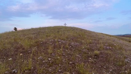 Cross on top of the hill,low angle aerial view
