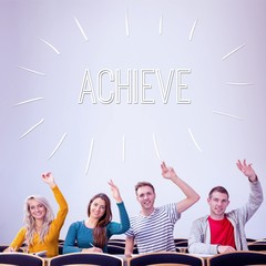 Achieve against college students raising hands in the classroom