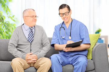 Male doctor talking to a senior patient