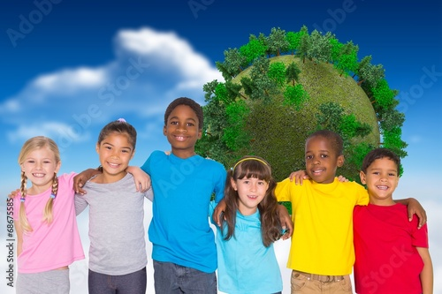canvas print picture Composite image of elementary pupils smiling