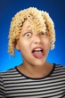 Funny teen girl with macaroni instead hair