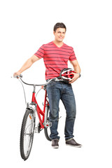 Young man with helmet and a bicycle