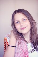 Beautiful happy teen girl with wet hair