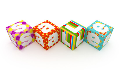 Sale word on colorful fabric cubes on white background