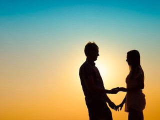 Young couple and sunset