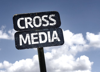 Cross Media sign with clouds and sky background