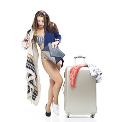Woman having problem with packing suitcase
