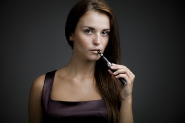 Elegant beautiful woman holding e-cigarette