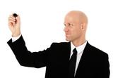 Middle aged bald businessman using marker