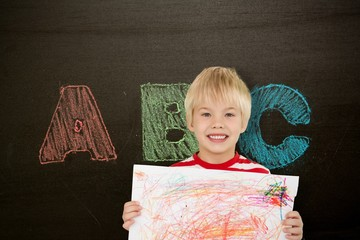 Composite image of cute boy showing his art