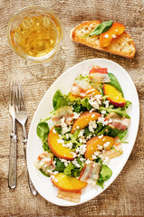 salad with peaches, bacon; arugula, spinach and goat cheese