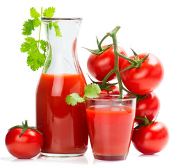 Bottle and glass of tomato juice and ripe tomatoes.