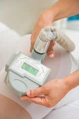 Therapist applying lipo massage  LPG therapy
