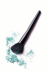 Blue eyeshadow powder with an applicator