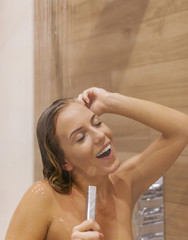 Beautiful woman singing under the shower