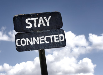 Stay Connected sign with clouds and sky background