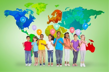 Composite image of elementary pupils holding balloons