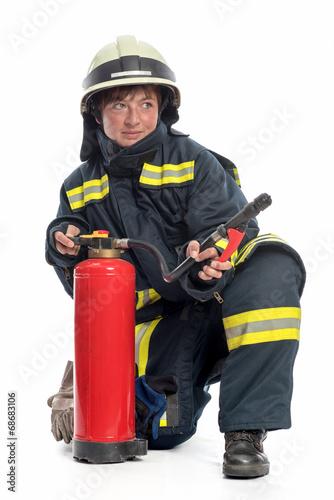 Leinwanddruck Bild Feuerwehrfrau mit Feuerlöscher