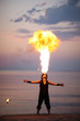 Impressive fire-breathing on the beach at sunset