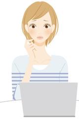 PC パソコンの操作で困る女性