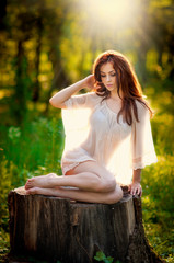 Young beautiful red hair woman wearing a transparent blouse