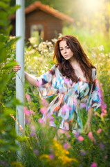 Beautiful red hair woman in multicolored blouse in sunny day