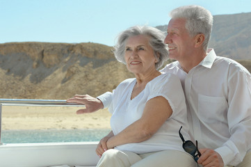 Elderly couple have a ride in a boat
