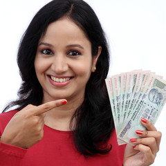 Young woman holding five hundred rupee notes