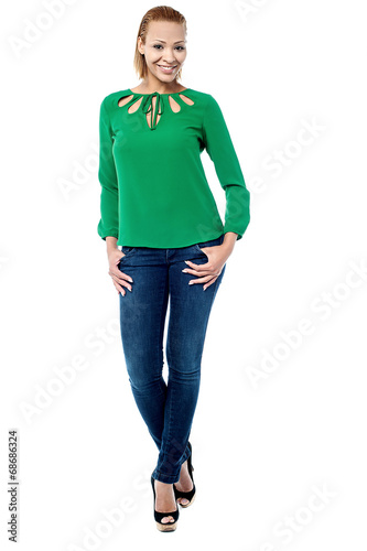 canvas print picture Young woman in green top, isolated on white