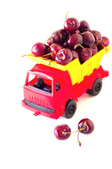 toy car with a cherry in the white  background