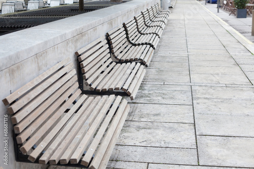 empty wooden benches - 68687176