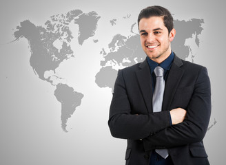 Businessman in front of a world map