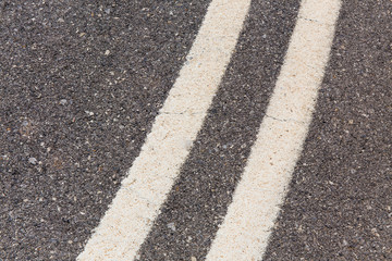 Double solid white line in the asphalt road