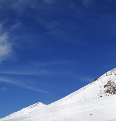 Winter snowy mountains and ski slope