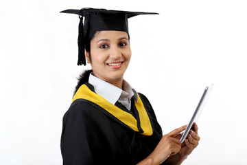 Young female graduated student using a tablet computer