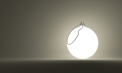 Glowing Christmas ball on gray background