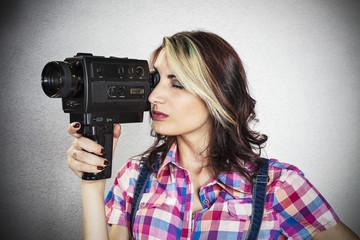Beautiful girl using a video camera