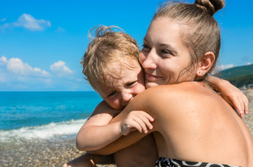 mum with small son on beach