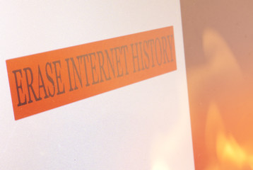 Erase Internet History sign on a computer screen and flames