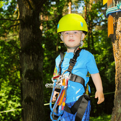 Portrait of a little boy in a special outfit for climbing