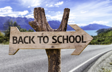 Back to School wooden sign with a street on background