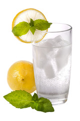 glass of cold sparkling water with lemon and mint
