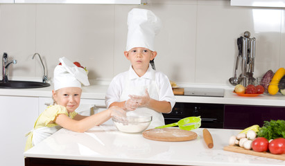 Cute Little Chefs Baking in Kitchen