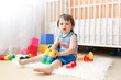 lovely baby wiht toys at home