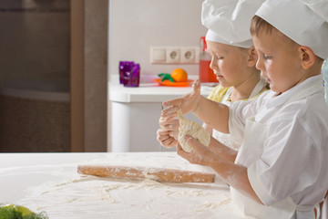 Two Very Young Chefs Preparing for Pizza