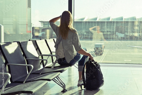 canvas print picture Girl at the airport window