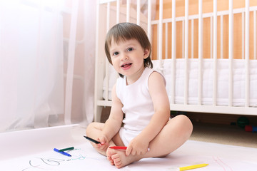 baby with felt-pens at home