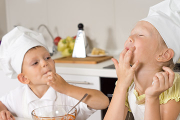 Adorable Kids in White Apron Tasting Food