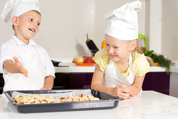 White Kids in Apron Made Pizza